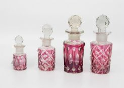 Four graduating ruby flash glass scent bottles