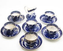 Six blue and white cups and saucers, and a jug