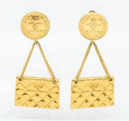 Chanel- a pair of retro Chanel gold plated 2.55 quilted handbag drop earrings, comprising CC logo