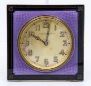An Art Deco sterling silver desk or bedside easel timepiece, circa 1920's, purple guilloche enamel