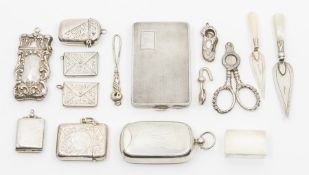Silver smoking and other accessories and requisites, to include a stamp/sovereign fob combined,