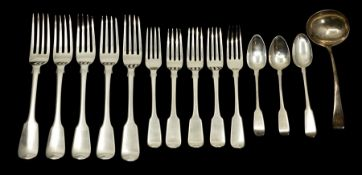 A composite suite of Georgian and Victorian silver flatware, mainly fiddle pattern, all with shell