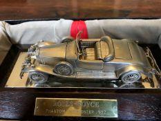 An Elizabeth II sterling silver desk model of a 1932 Rolls-Royce Phantom II Roadster, Magna