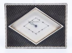 A French Art Deco Mappin & Webb retailed white metal desk or bedside easel timepiece, of rectangular