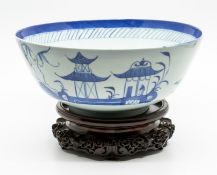 A Chinese blue and white sideboard bowl, Qianlong period, the frieze decorated with a naive figure