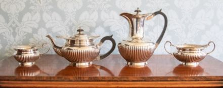 A George V four piece silver tea set, circular stop-fluted shapes with foliate borders maker