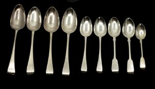 A composite suite of Georgian and Victorian silver flatware, old English and fiddle pattern, all