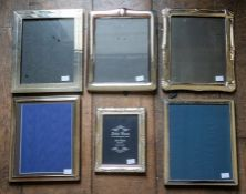 Two modern silver framed easel photograph frames, openings approximately 25 by 20cm, together with