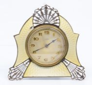 An Art Deco silver desk of bedside easel timepiece, pierced and yellow guilloche enamel frame, maker