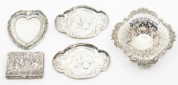 Five items of dressing table and small silver, to include a pierced bon bon dish, a pair of cherub