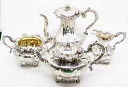 A mid Victorian silver four piece tea set, melon shapes with gilt interiors, fruit finials,