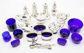 A collection of assorted silver hallmarked condiments, to include five mustard drums, a pair of oval