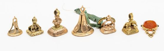 A collection of seven assorted George III and other 19th Century seal fobs, all unmarked yellow