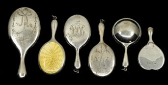 A collection of six miniature or toy silver hand mirrors, three with bright cut engraved backs,