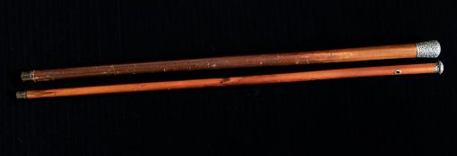 A late Victorian malacca walking cane, repousse scroll silver pommel, Birmingham 1876, length