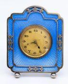 An Art Deco desk or bedside easel timepiece, pierced silver frame, blue guilloche ground, maker