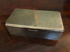 A George V silver table cigarette casket, machine engraved Art Deco design to the cover, maker