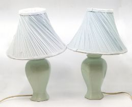 A pair of modern table lamps, extensive damage and repair of to both bases (2) AF with shades