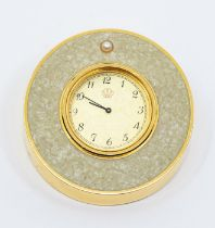 A Mikimoto International travel clock, comprising a gold tone round dial, with number markers,