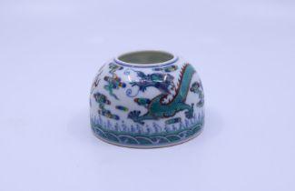 A Chinese porcelain Doucai brush pot bearing Qianlong mark to base