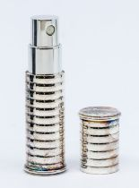 A Christofle Paris silver plated atomiser, ribbed plated case, length approx 80mm, total gross