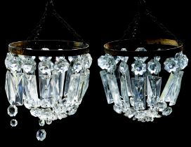A pair of early 19th Century style cut glass small chandeliers possibly German, gilt metal frames (