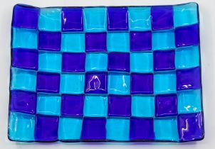 An Italian Murano blue glass chequer board serving plate, signed to reverse Provenance Baroness