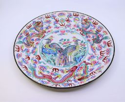 A Chinese Qing dynasty enamel Phooenix charger