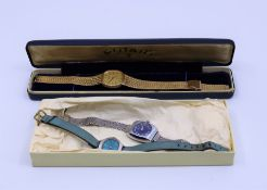 A ladies Garrard wristwatch, A cased Rotary watch and a smilar ladies watch
