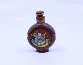 A Chinese yixing clay snuff bottle depicting scenes of lohan