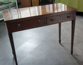 A Georgian style hallway table, with two draws, supported on tapered legs Provenance Baroness