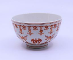 A Chinese porcelain bowl decorated in fine enamel decoration with knots and bats , bearing