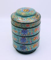 A Chinese Qing dynasty Blue enamel Cannister with central Shou cartouche