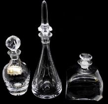Three various glass decanter and stoppers; one cushion shaped engraved with Dutch House of