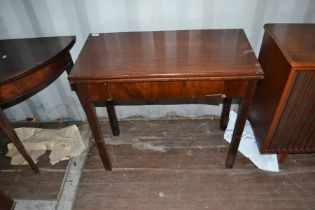 A George III mahogany tea table, fitted with a single drawer, raised on square legs, circa 1770,