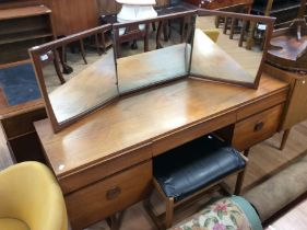 A 1970s teak dressing table, mirrored back, fitted with three frieze drawers and two doors