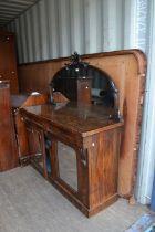 A late Victorian walnut chiffonier, having a mirrored back, 153cm high, 136cm wide, 47cm deep