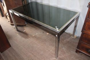 A contemporary Italian chrome framed and glass inset dining table, square supports