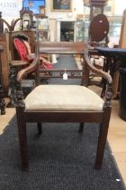 A George III mahogany open armchair, inset seat, raised on square legs together with an early