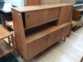 A Portwood teak 1970s side unit, two sliding doors to top, fold down cupboard, with two doors and