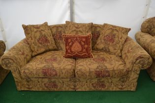 A Classic three piece suite, comprising a small two seater settee, a large two seater settee, a
