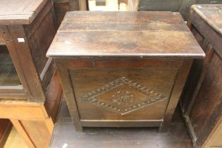 A 17th Century or later oak lidded box, possibly cut down from a larger piece, with a lozenge carved