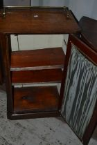 A late Victorian walnut music cabinet, single glazed door, brass gallery, 90cm high