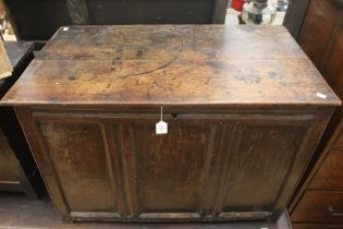 A 17th Century joined oak chest, plank top, panelled front, single storage section, 63cm high,