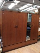 Two matching 1970s teak veneered wardrobes, comprising single mirrored wardrobe and a further double