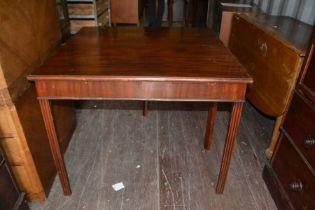 A George III mahogany fold-over tea table, raised on square legs, 74cm high, 91cm wide, 45cm deep