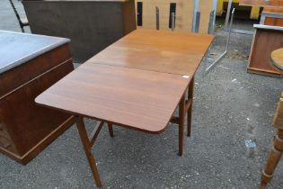 A teak drop leaf dining table and a set of four chairs; the table measuring 72cm high, 75cm wide,