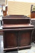 An early Victorian mahogany chiffonier, circa 1850, scroll carved back, the front with convex