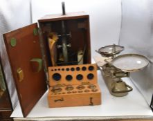 An A Baker 43843 London microscope (boxed) and a set of vintage scales with boxed weights (2)
