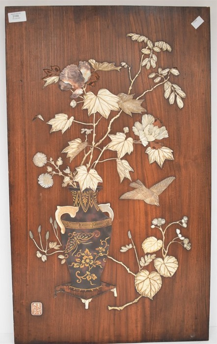 A Japanese panel inset with raised decoration depicting vase of flowers on table with bird,